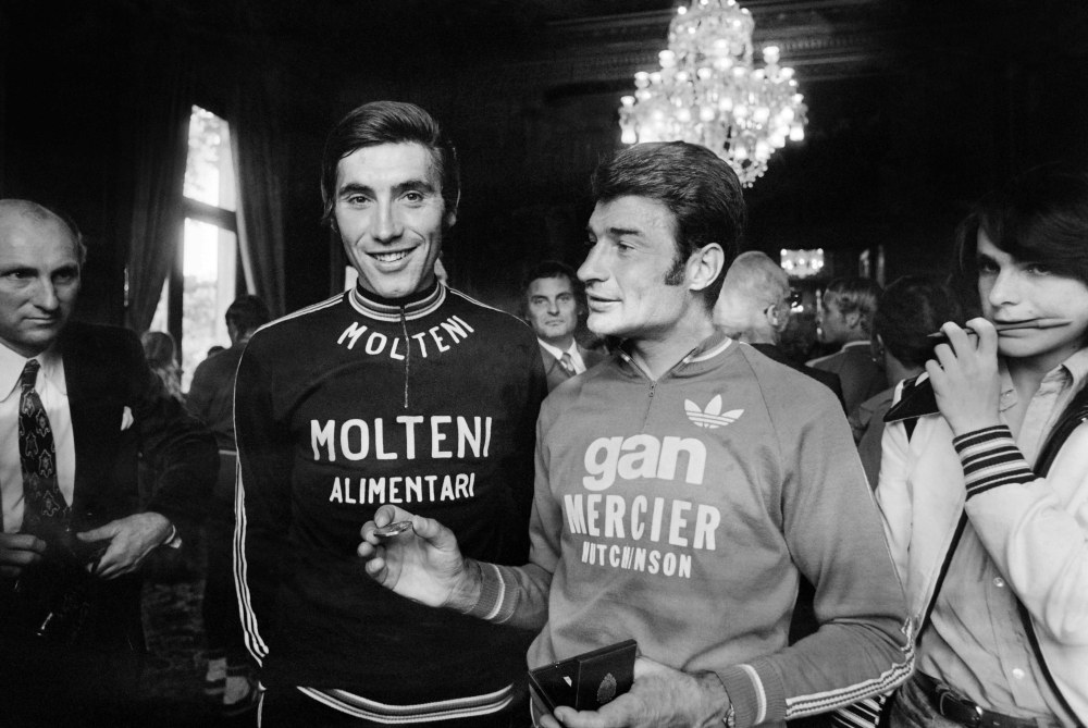 In this file photo taken on Sept. 5, 1978 former French Bicycle racer Raymond Poulidor (R) and François Gadot-Clet, French CEO of Manufrance, French Arms and Cycle Factory of St. Etienne, offer a bike to young girl Christine Donna, in Clermont Ferrand. Poulidor died on Nov. 13, 2019 aged 83, his family announced. — AFP