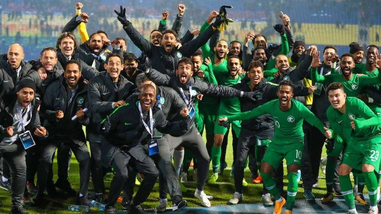 The Saudi Arabian soccer team celebrates the 3-2 victory over Uzbekistan in Group D of the Asian Qualifiers on Thursday in Tashkent.
