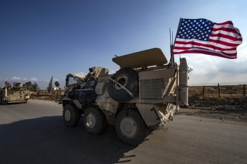 A convoy of US troops is pictured outside the Kurdish-majority city of Qamishli, in Syria's northeastern Hasakeh province, in this Nov. 02, 2019 file photo. — AFP