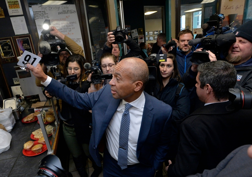 Former Massachusetts Governor Deval Patrick, US Democratic Presidential hopeful, orders lunch and greets locals at the Bridge Cafe on Thursday in Manchester, New Hampshire. — AFP