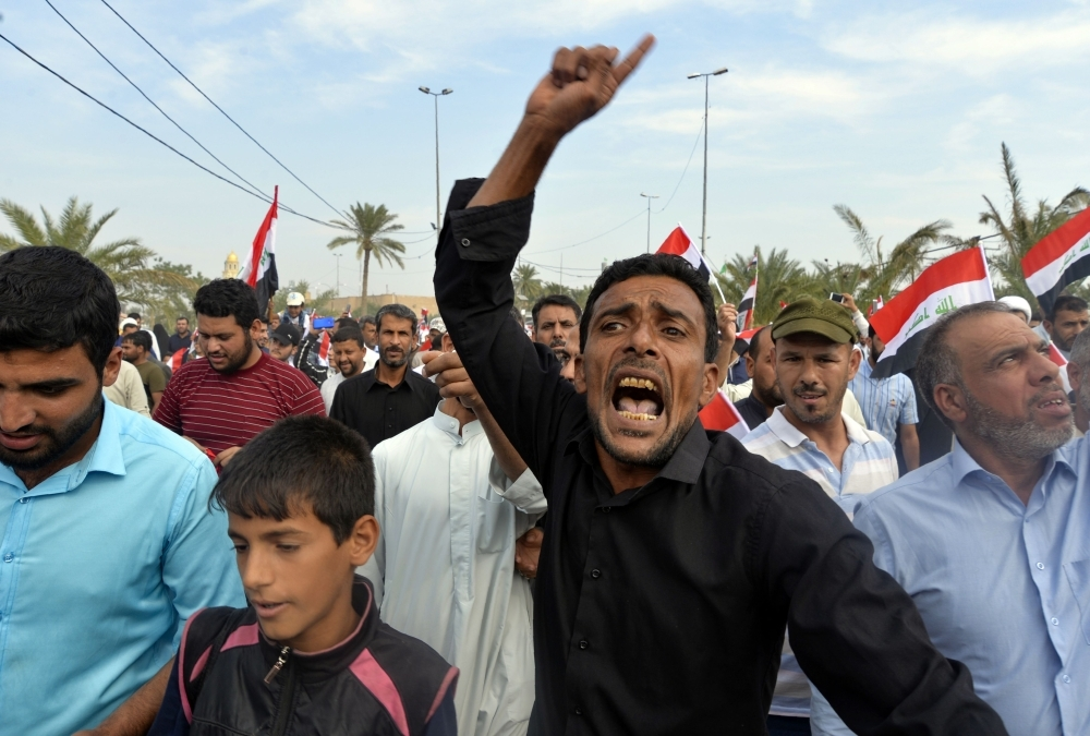 Iraqis take part in a rally in the central holy city of Najaf on Friday to show solidarity with anti-government protesters in the capital Baghdad. — AFP