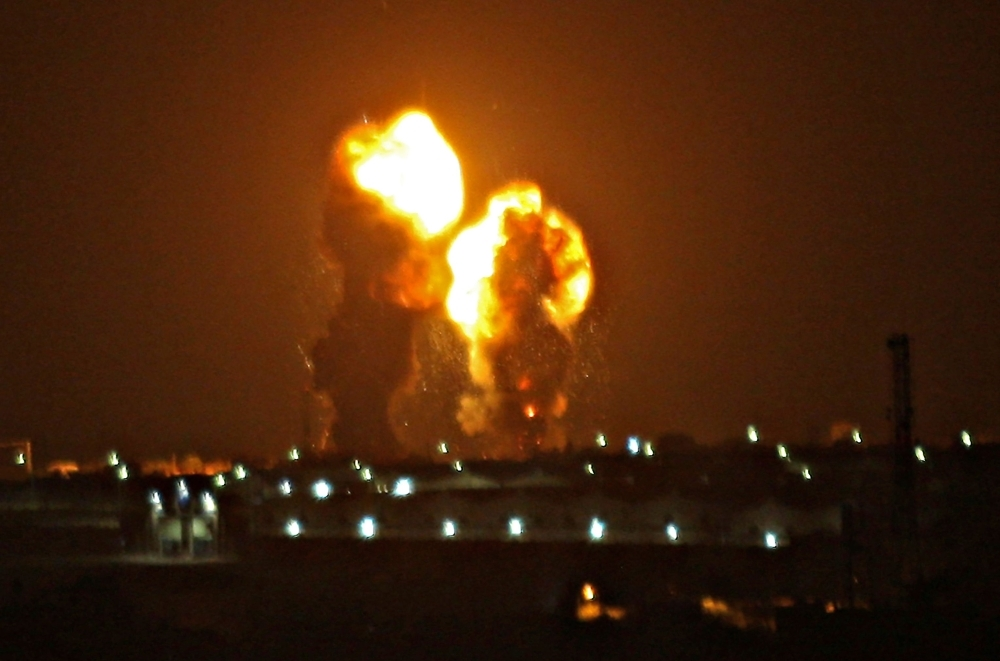 Two balls of fire are seen following an Israel air strike in Khan Yunis in the southern Gaza Strip early on Friday. — AFP