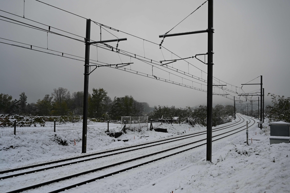 Railways are seen covered with snow in Tournon-sur-Rhone, France, on Friday — AFP