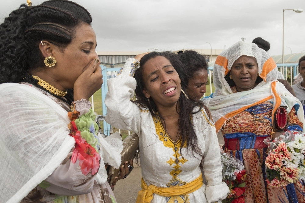 Azmera Addisalem, second left, and her family get emotional after meeting her father (who is an Ethiopian journalist) for the first time in twenty years, upon his arrival at the Asmara International airport in this July 18, 2018 file photo. — AFP