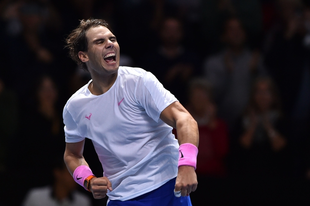 Spain's Rafael Nadal celebrates victory against Greece's Stefanos Tsitsipas during their men's singles round-robin match on day six of the ATP World Tour Finals tennis tournament at the O2 Arena in London on Friday. — AFP