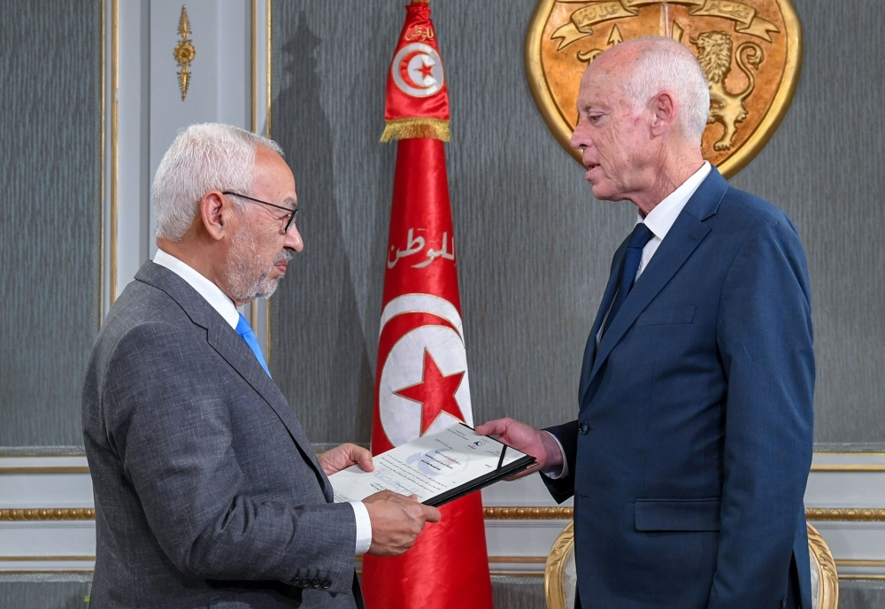 Tunisia's President Kais Saied, right, receives Ennahdha leader and parliament speaker Rached Ghannouchi at the presidential palace in the capital's eastern suburb of Carthage on Friday. — AFP