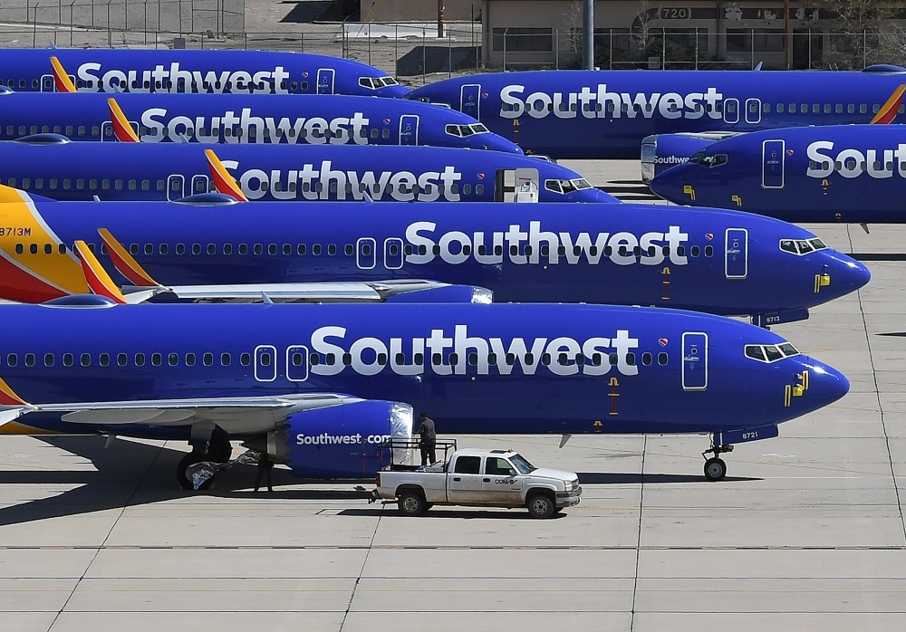 In this file photo taken on March 28, 2019 Southwest Airlines Boeing 737 MAX aircraft are parked on the tarmac after being grounded, at the Southern California Logistics Airport in Victorville, California. — AFP
