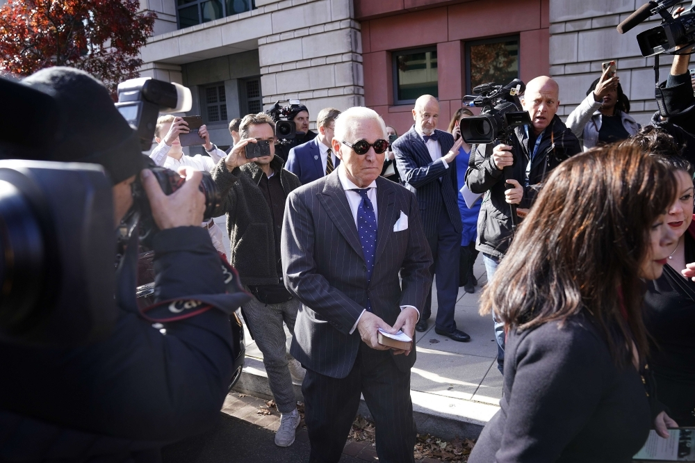 Former advisor to US President Donald Trump, Roger Stone, departs the E. Barrett Prettyman United States Courthouse with his wife Nydia (R) after being found guilty of obstructing a congressional investigation into Russias interference in the 2016 election on Friday in Washington, DC. Stone faced seven felony charges and was found guilty on all counts. _ AFP