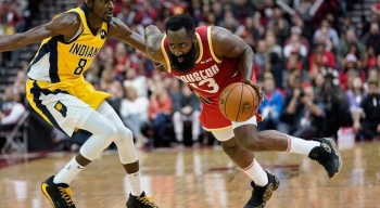 Houston Rockets' James Harden (13) drives toward the basket as Indiana Pacers' Justin Holiday (8) defends during the second half of an NBA basketball game in Houston, on Friday. The Rockets won 111-102. — Courtesy photo