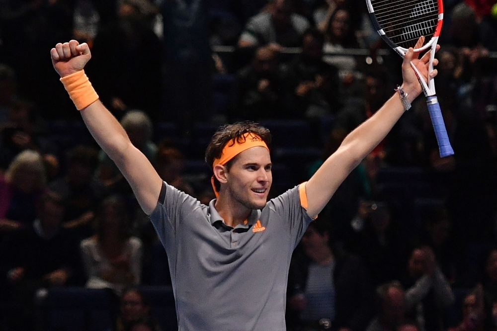 Austria's Dominic Thiem celebrates his straight sets victory over Germany's Alexander Zverev in the men's singles semi-final match on day seven of the ATP World Tour Finals tennis tournament at the O2 Arena in London, on Saturday. — AFP