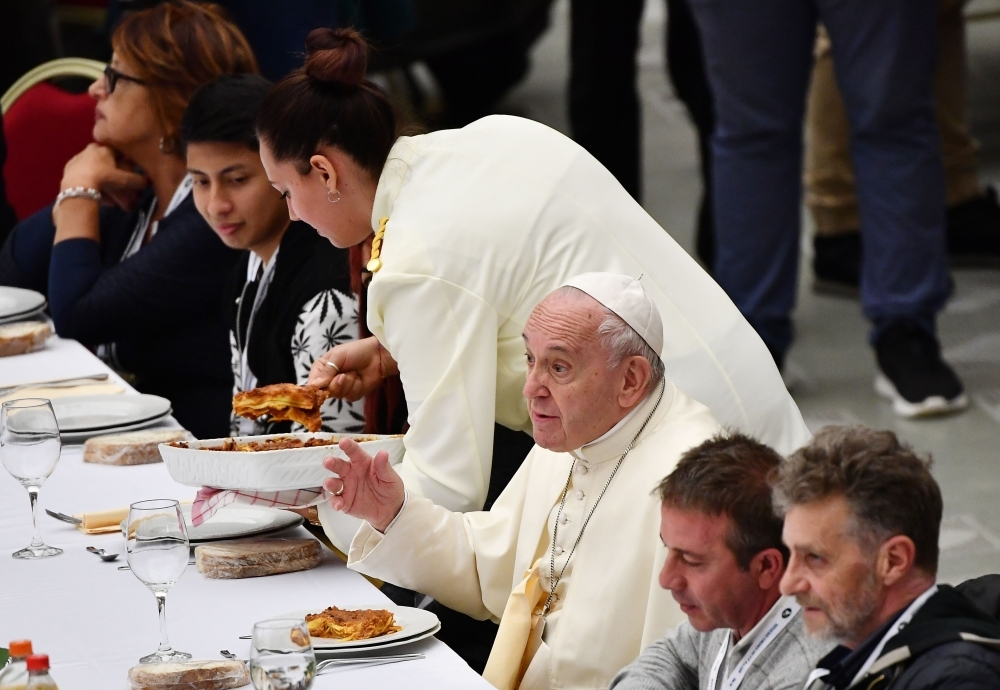 Pope Francis (C) has a lunch with people, on Sunday, at the Paul VI audience hall in Vatican, to mark the World Day of the Poor. — AFP