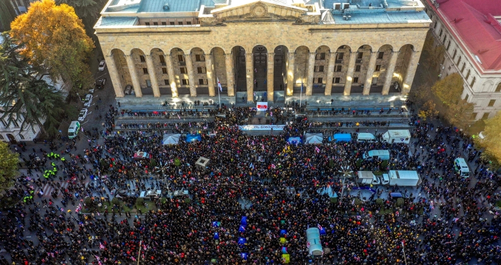 An aerial view of a crowd of Georgian opposition supporters gathered outside the parliament of Georgia in central Tbilisi, to demand the government's resignation and early parliamentary polls. In the biggest anti-government rally in years, protesters demonstrated outside the parliament building on the capital Tbilisi's main thoroughfare. — AFP