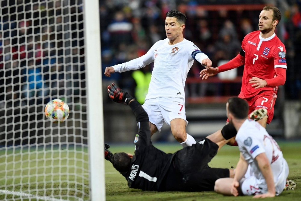 Portugal's forward Cristiano Ronaldo (C) scores a goal during the UEFA Euro 2020 Group B qualification football match between Luxembourg and Portugal at the Josy Barthel Stadium in Luxembourg, on Sunday. — AFP