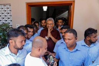 Sri Lanka Podujana Peramuna (SLPP) party presidential candidate Gotabaya Rajapaksa (C) gestures to supporters and well-wishers after his victory outside his house in Colombo on Sunday. -AFP
