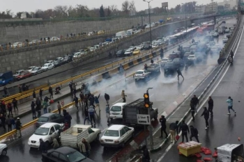 People protesting against increased petrol prices on a highway in Tehran on Saturday. -Courtesy photo