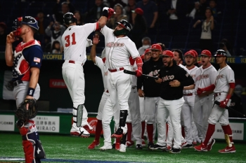 Matthew Clark of Mexico (n°31) is congratulated by teammates after a home run during the WBSC Premier 12 Super Round bronze medal baseball game between the USA and Mexico, at the Tokyo Dome in Tokyo, on Sunday. — AFP
