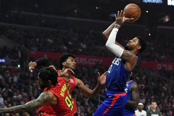LA Clippers forward Paul George taking a shot over center Damian Jones and guard DeAndre' Bembry of the Atlanta Hawks on Sunday. — Courtesy photo