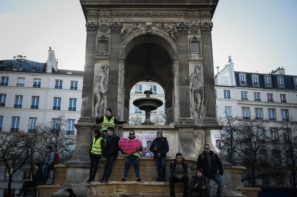 Yellow vest protesters stand at the