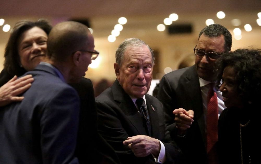 Michael Bloomberg (center) prepares to speak at the Christian Cultural Center on Sunday in the Brooklyn borough of New York City. -AFP