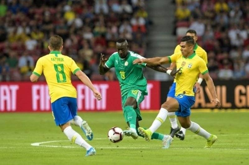 Diedhiou, seen here in action during a friendly against Brazil, missed a penalty before claiming his treble. — AFP