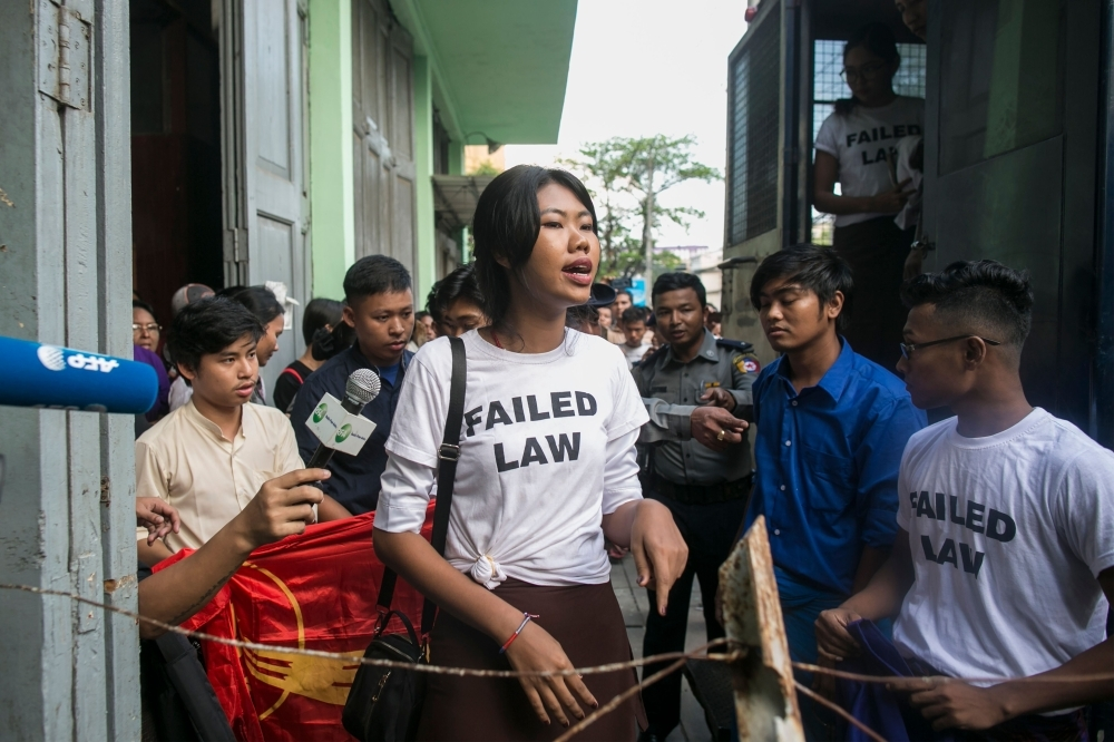 Kay Khaing Tun, a performer of Peacock Generation group, speaks to journalists peak after a trial in Yangon on Monday. — AFP