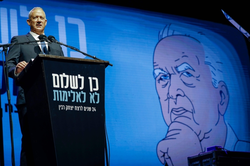 Israeli Kahol Lavan (Blue and White) political alliance leader and retired Israeli General Benny Gantz addresses the crowds during a rally to mark the 24nd anniversary of the assassination of former Israeli Prime Minister Yitzhak Rabin, at Rabin Square in Tel Aviv, in this Nov. 2, 2019 file photo. — AFP