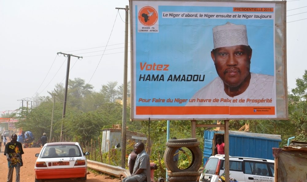 A campaign poster depicting then Niger's leading opposition figure and contender in the presidential election Hama Amadou is seen in Niamey in this Feb. 2, 2016 file photo. — AFP