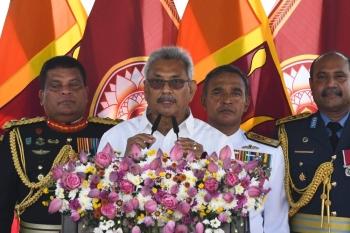 Sri Lanka's President Gotabaya Rajapaksa (C) speaks during his swearing-in ceremony at the Ruwanwelisaya temple in Anuradhapura on Monday. -AFP