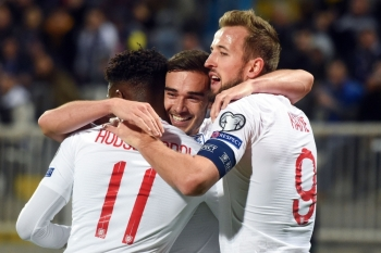England's Harry Winks (C) celebrates with teammates after scoring a goal during the UEFA Euro 2020 qualifying Group A football match between Kosovo and England in Prishtina on Sunday. — AFP
