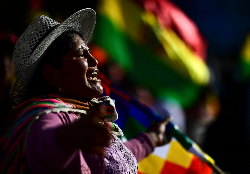 Supporters of Bolivian ex-President Evo Morales shout slogans during a demonstration in Cochabamba, on Monday. -AFP