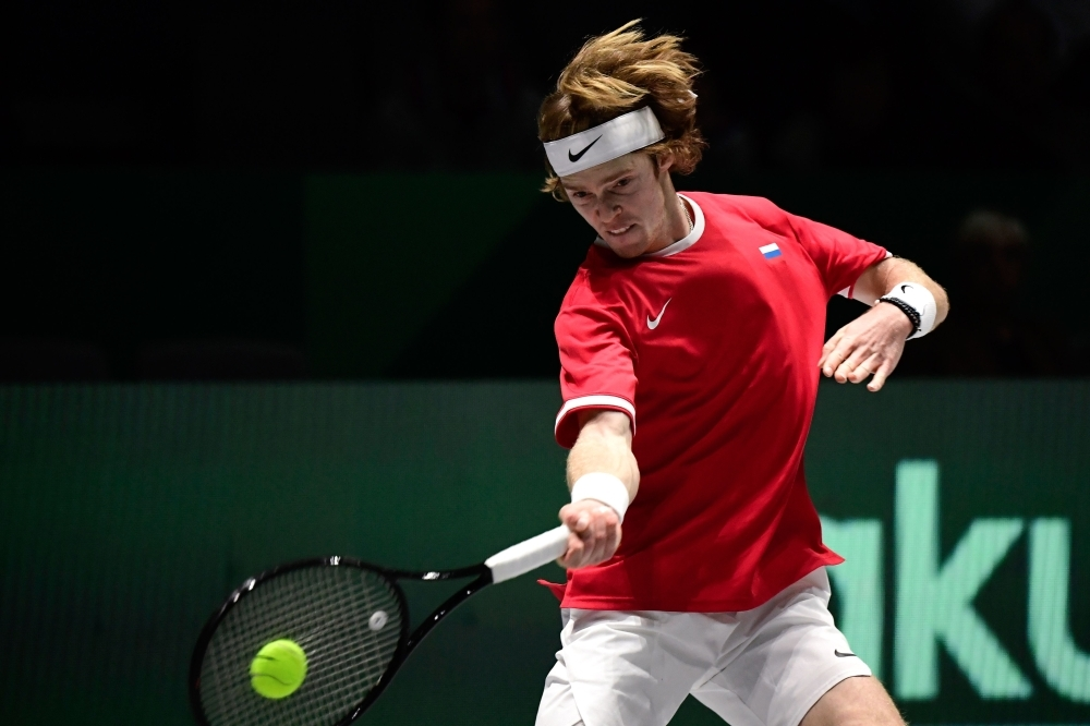 Russia's Andrey Rublev returns the ball to Croatia's Borna Coric during the singles tennis match between Croatia and Russia at the Davis Cup Madrid Finals 2019 in Madrid on Monday. — AFP