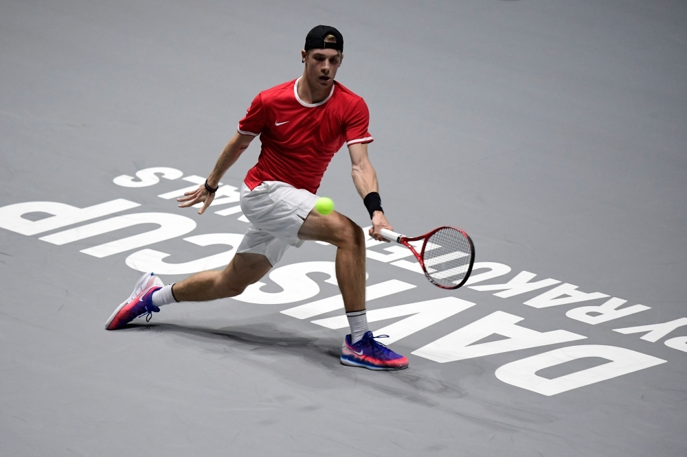 Canada's Denis Shapovalov returns the ball to Italy's Matteo Berrettini during the singles tennis match between Italy and Canada at the Davis Cup Madrid Finals 2019 in Madrid on Monday. — AFP
