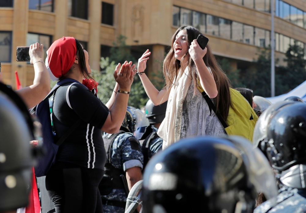 Lebanese protesters chant slogans during a demonstration at Riad Al-Solh square near the government palace and the parliament headquarters in the capital Beirut's downtown district on Tuesday. — AFP