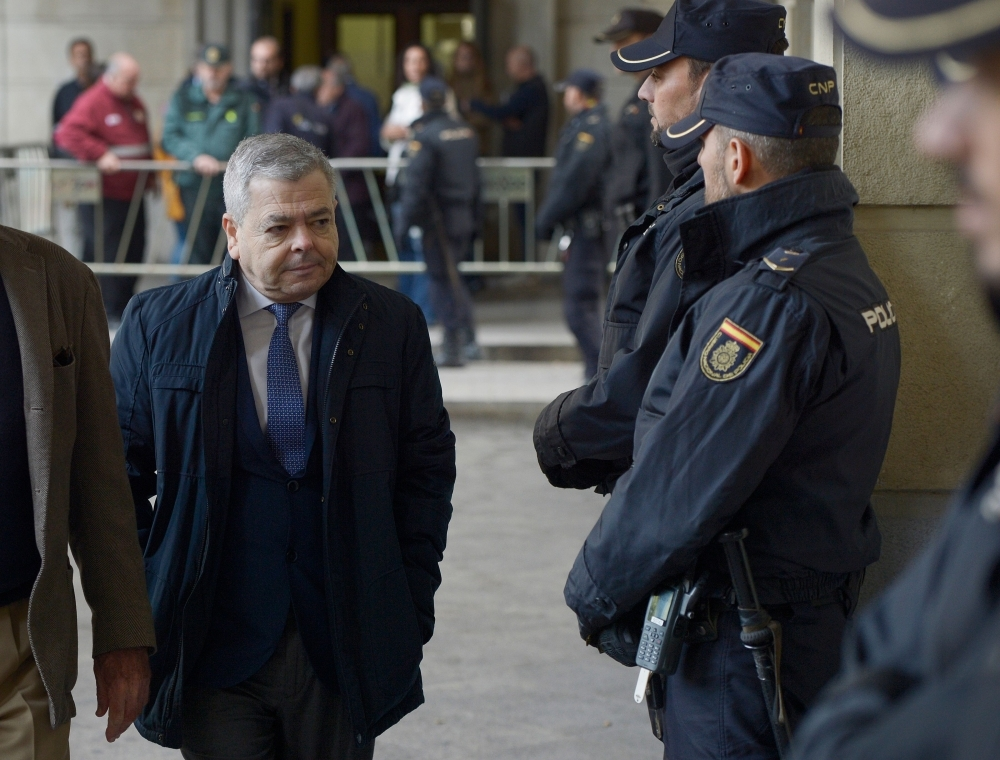 Former Employment Councillor Agustin Barbera arrives at the courthouse in Seville, Spain, on Tuesday. — AFP