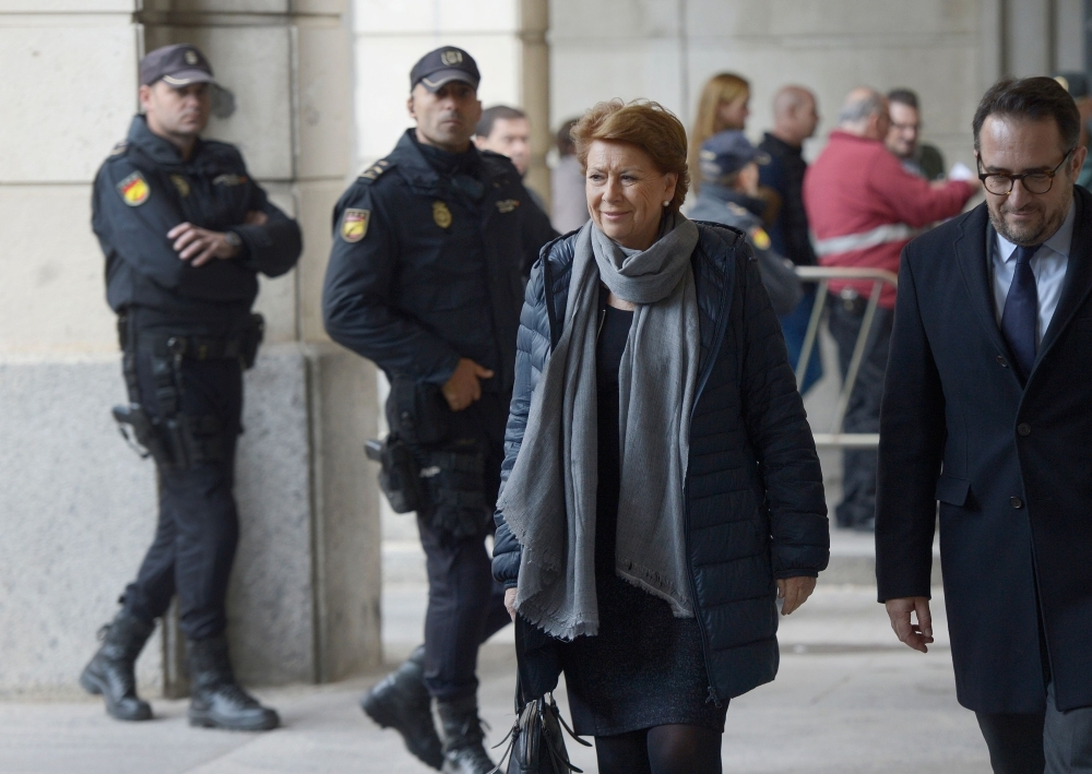 Former Minister of Public Works Magdalena Alvarez, left, arrives at the courthouse in Seville, Spain, on Tuesday. — AFP