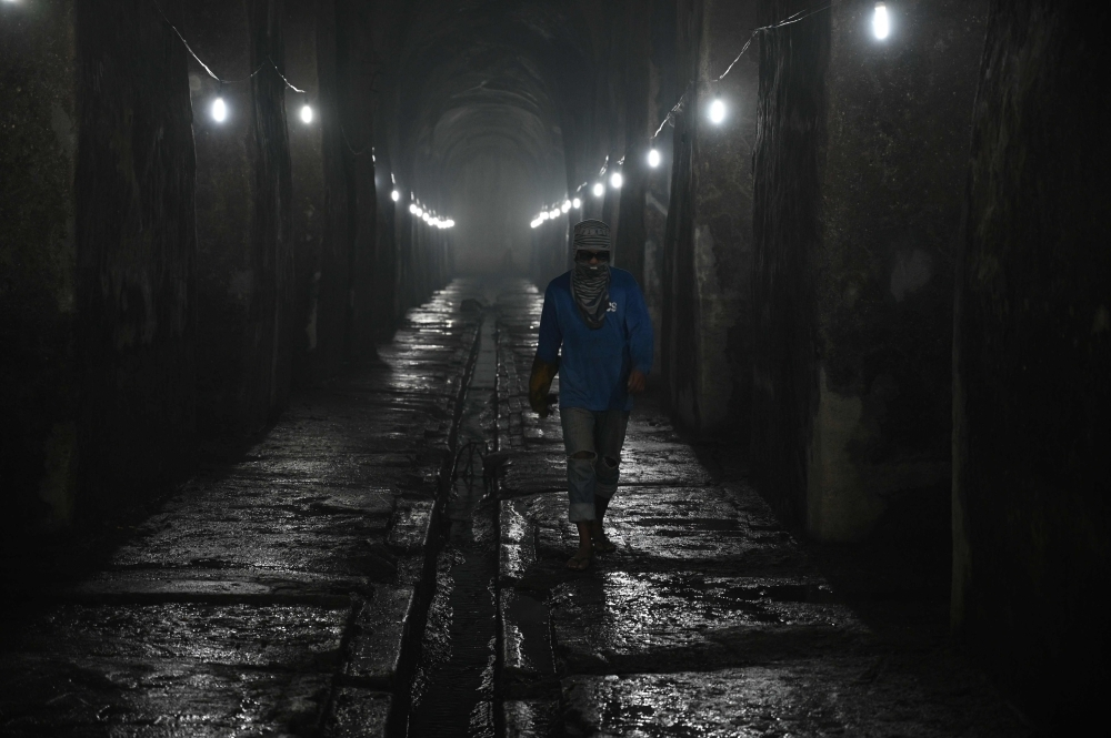 A worker walks inside at the El Deposito, a Spanish-era water reservoir being rehabilitated for tourism, in San Juan town, suburban Manila, in this Nov. 6, 2019 file photo. — AFP