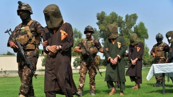 Afghan security personnel escort arrested alleged Taliban and Daesh (the so-called IS) militants during an operation in Jalalabad province in this Oct. 1, 2019 file photo. — AFP