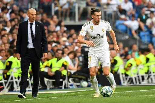 Real Madrid coach Zinedine Zidane must decide whether to punish Gareth Bale after his latest act of rebellion while playing for Wales. — AFP/File