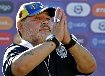 In this file photo taken on Nov. 02, 2019, Gimnasia team coach Diego Armando Maradona gestures to supporters as he leaves the field after an Argentina First Division Superliga football match against Estudiantes, at El Bosque stadium, in La Plata, Buenos Aires province, Argentina. Diego Maradona resigned on Tuesday, as coach of Argentina's first-division club Gimnasia y Esgrima La Plata, the president of the club, Gabriel Pellegrino, said. — AFP