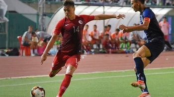 Hong Kong's James Stephen Gee Ha controls the ball next to Cambodia's Soeuy Visal during the Qatar 2022 World Cup qualifying football match between Cambodia and Hong Kong in Phnom Penh in this Sep 5, 2019 file photo. — AFP