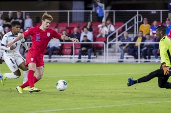 In this file photo taken on Oct. 11, 2019, Josh Sargent (19) of the United States shoots the ball against Nelson Johnston (21) of Cuba during the first half at Audi Field in Washington, DC. Jordan Morris and teenager Josh Sargent scored two goals apiece as the United States eased into the final four of the CONCACAF Nations League on Tuesday with a 4-0 win over Cuba. — AFP