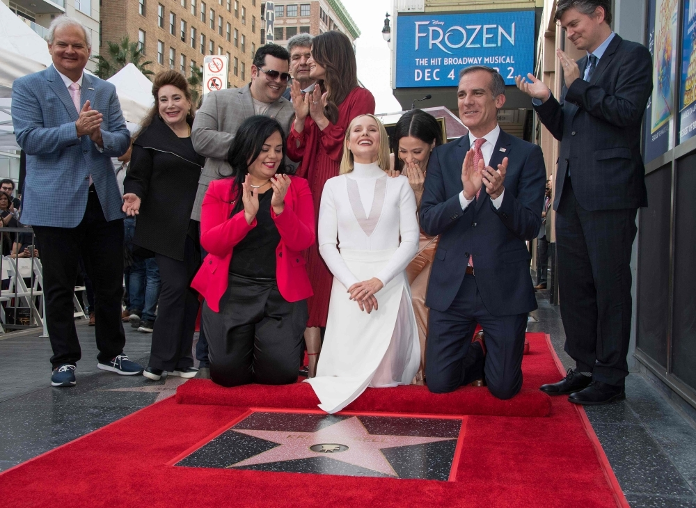 Actress Kristen Bell, center, is honored with a star on the Hollywood Walk of Fame, in Hollywood, California, in this Nov. 19, 2019 file photo. — AFP