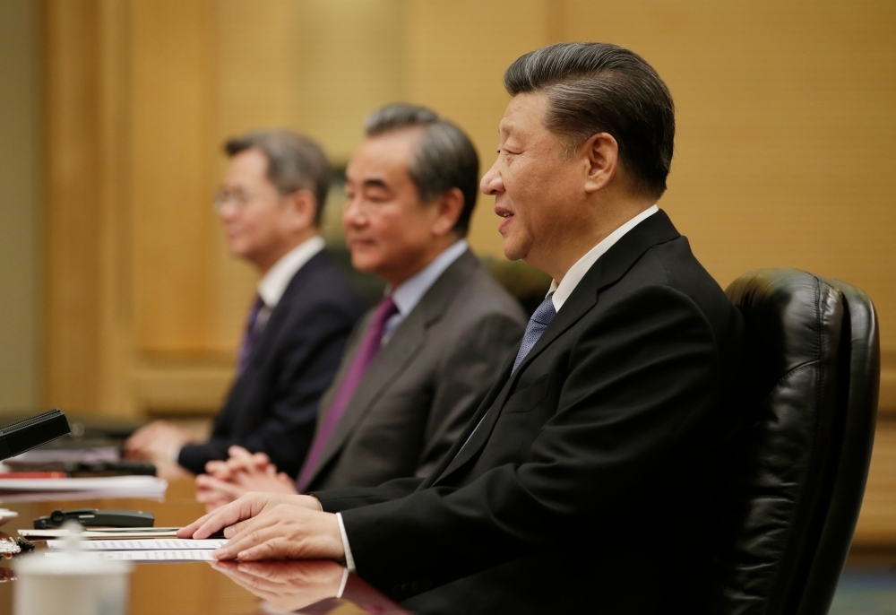 China's President Xi Jinping, right, speaks during a meeting with International Monetary Fund (IMF) Managing Director Kristalina Georgieva, not pictured, at the Great Hall of the People in Beijing on Friday. — AFP