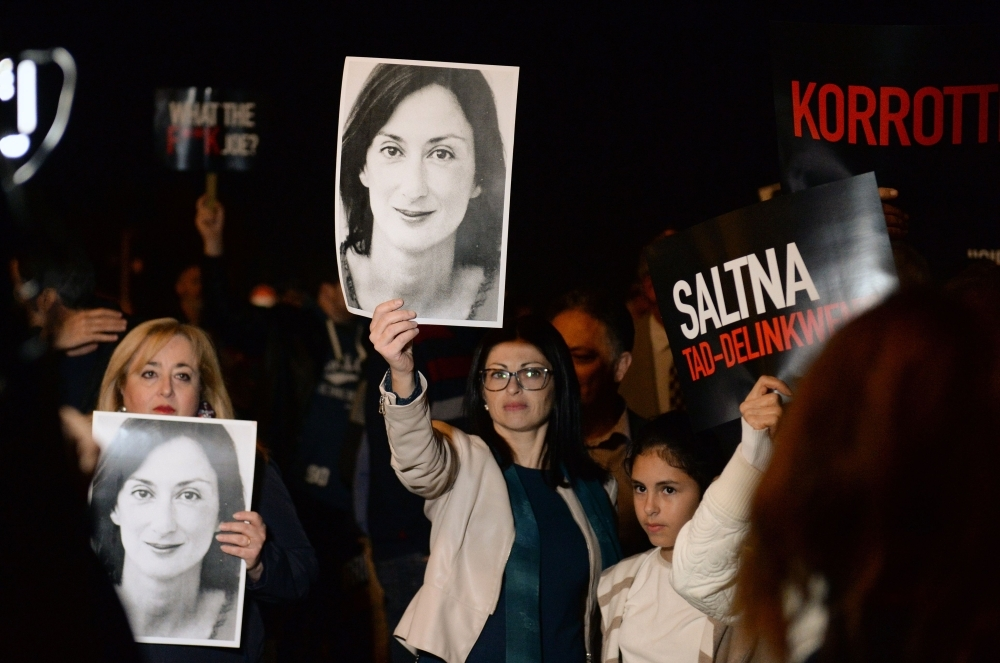 Protesters hold up placards and pictures of the late journalist Daphne Caruana Galizia as they gather outside the prime minister's office in Valletta, Malta, in this Nov 20, 2019 file photo. — AFP