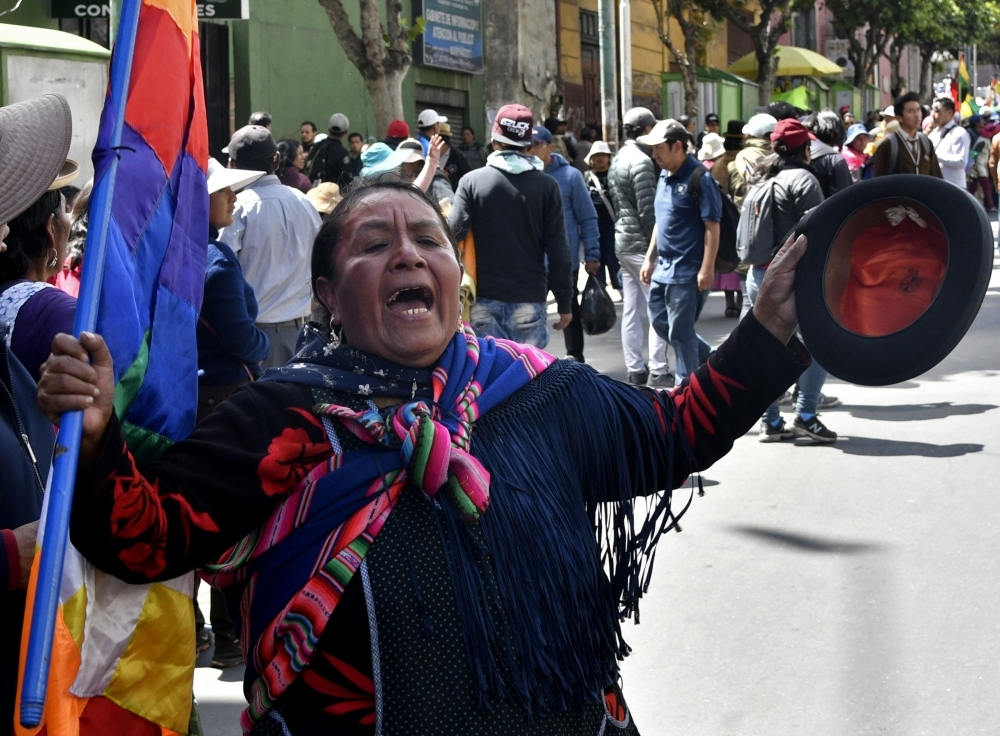 An indigenous woman attends the funeral procession of eight supporters of Bolivia's ex-President Evo Morales, killed when security forces lifted a siege on a fuel plant, in La Paz on Thursday. — AFP