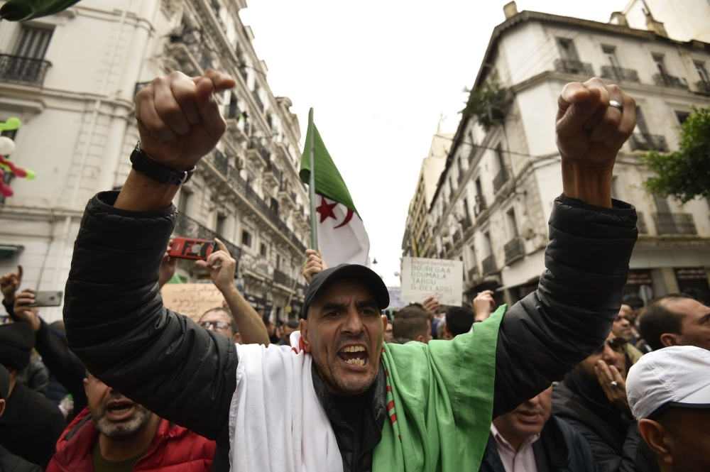 An Algerian protester gestures during an anti-government demonstration in the center of the capital Algiers on on Friday. — AFP
