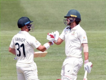 Australian opening pair David Warner and Joe Burns share a 222-run stand in the first Test against Pakidan in Brisbane on Friday.