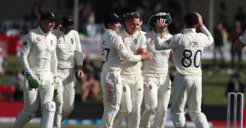 England players celebrate the fall of key New Zealand wicket on the second day of the first Test at Mount Maunganui on Friday.