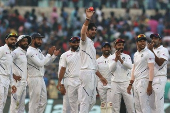 India's Ishant-Sharma shows off the pink ball, with his teammates applauding, after his five-wicket demolition of Bangladesh in the Day-Night Test at Kolkata on Friday.