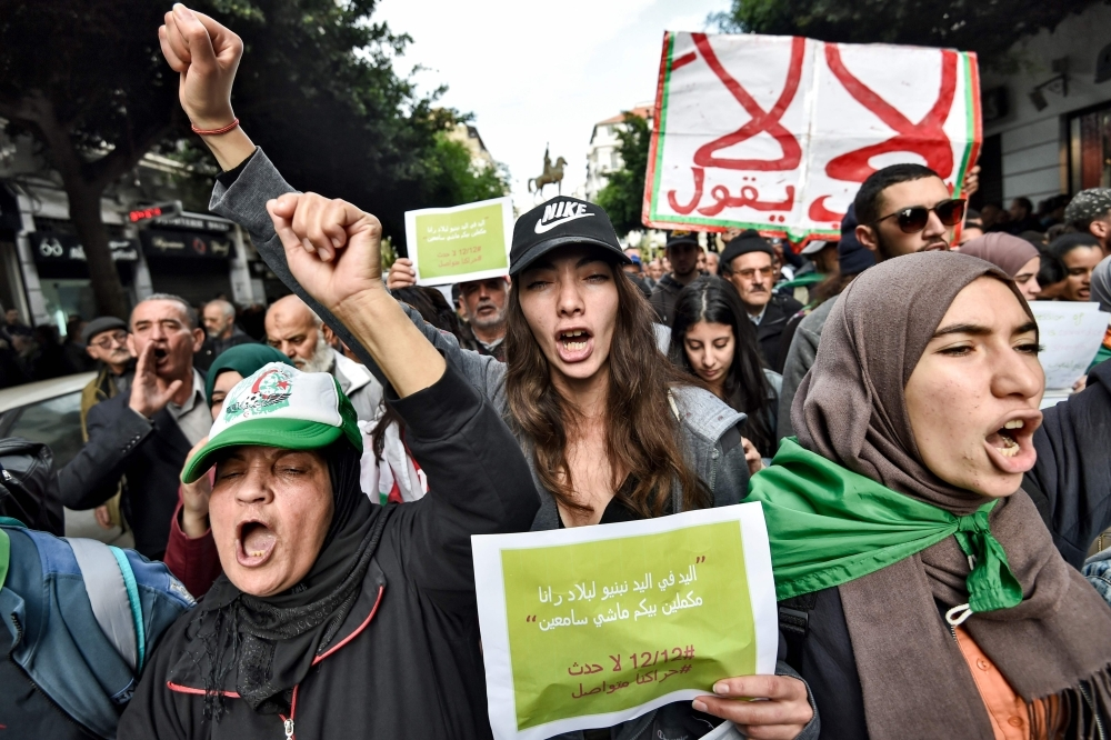 Algerians chant slogans as they march during an anti-government demonstration in the Algerian capital Algiers in this Dec. 3, 2019 file photo. — AFP